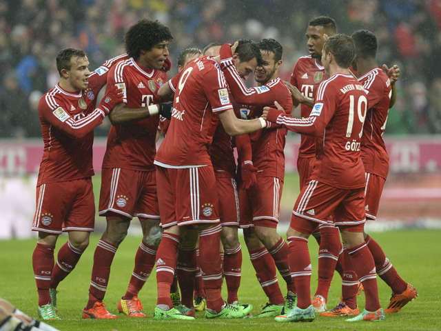 Bayern players celebrate their team's second goal during the German first division Bundesliga football match FC Bayern Munich vs Eintracht Frankfurt at the Allianz Arena in Munich, southern Germany on February 02, 2014