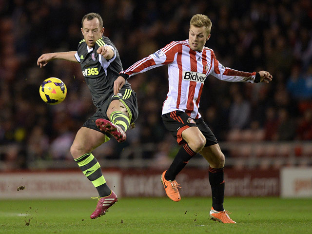 Sunderland's Sebastian Larsson and Stoke's Charlie Adam in action during their Premier League match on January 29, 2014