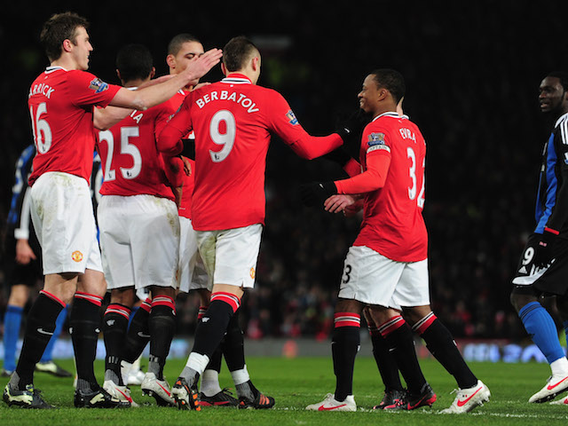Dimitar Berbatov of Manchester United celebrates his goal with team mates during the Barclays Premier League match against Stoke City on January 30, 2012