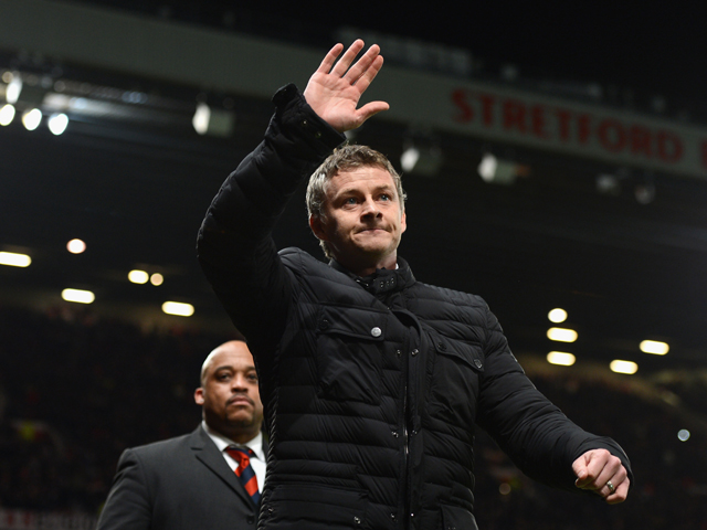 Cardiff City Manager Ole Gunnar Solskjaer salutes the crowd prior to the Barclays Premier League match between Manchester United and Cardiff City at Old Trafford on January 28, 2014