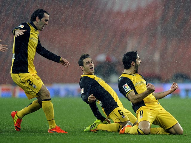 Atletico Madrid's Raul Garcia celebrates with teammates after scoring his team's first goal against Athletic Bilbao during their Copa del Rey match on January 29, 2014