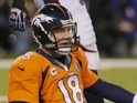 Quarterback Peyton Manning #18 of the Denver Broncos sits on the ground in the fourth quarter while taking on the Seattle Seahawks during Super Bowl XLVIII on February 2, 2014