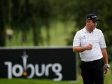 Alastair Forsyth prepares to putt on the 14th green during Day One of the Joburg Open on February 6, 2013