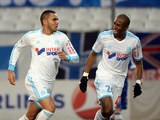 Marseille 's Dimitri Payet celebrates with teammate Rod Fanni after scoring the opening goal against Bastia during their Ligue 1 match on February 8, 2014