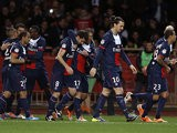 PSG's Javier Pastore is congratulated by teammates after scoring the opening goal against Monaco on February 9, 2014