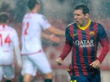 Barcelona's Lionel Messi celebrates after scoring his team's second goal against Sevilla during their La Liga match on February 9, 2014