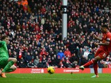 Raheem Sterling of Liverpool scores the fifth goal during the Barclays Premier League match between Liverpool and Arsenal at Anfield on February 8, 2014