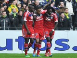 's French forward Alexandre Lacazette is congradulated by Lyon's French defender Samuel Umtiti and Lyon's French forward Bafetimbi Gomis during the French L1 football match between Nantes and Lyon on February 9, 2014