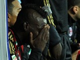 Mario Balotelli of Milan crying on the bench after being replaced during the Serie A match between SSC Napoli and AC Milan at Stadio San Paolo on February 8, 2014