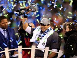 Russell Wilson #3 of the Seattle Seahawks celebrates with the Vince Lombardi trophy after defeating the Denver Broncos 43-8 in Super Bowl XLVIII  on February 2, 2014