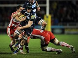 James Gaskell of Sale Sharks is tackled by Sione Ka