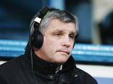 Pundit Tony Gale sits in the commentary box during the Barclays Premiership match between Portsmouth and West Ham United at Fratton Park on December 26, 2005