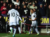 Swansea's Wayne Routledge celebrates after scoring the opening goal against Cardiff during their Premier League match on February 8, 2014