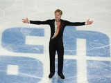 Russia's Yevgeny Plushenko smiles after performing in the Men's Figure Skating Team Short Program at the Iceberg Skating Palace during the Sochi Winter Olympics on February 6, 2014