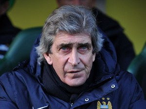 Manchester City's Chilean manager Manuel Pellegrini looks on ahead of the English Premier League football match between Norwich City and Manchester City at Carrow Road in Norwich, eastern England on February 8, 2014