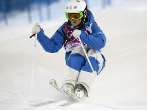 France's Perrine Laffont competes in the Women's Freestyle Skiing Moguls qualifications at the Rosa Khutor Extreme Park during the Sochi Winter Olympics on February 6, 2014