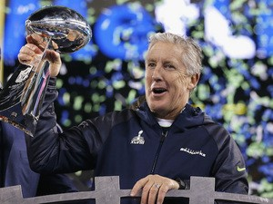 Head coach Pete Carroll of the Seattle Seahawks celebrates with the Vince Lombardi Trophy after their 43-8 victory over the Denver Broncos during Super Bowl XLVIII on February 2, 2014
