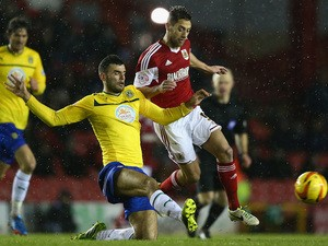 Sam Baldock (R) of Bristol City is challenged by Conor Thomas (L)of Coventry City during the Sky Bet League One match on February 4, 2014