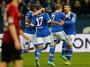 Schalke players celebrate the opening goal against Hannover during their Bundesliga match on February 9, 2014