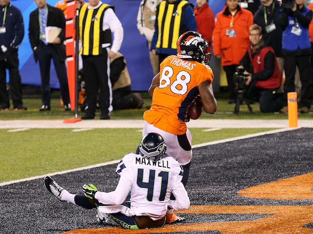 Wide receiver Demaryius Thomas #88 of the Denver Broncos scores on a 14 yard pass during Super Bowl XLVIII against the Seattle Seahawks at MetLife Stadium on February 2, 2014