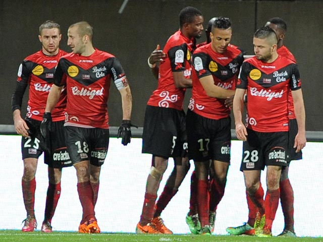 Guingamp's players celebrate after taking the lead against Reims during their Ligue 1 match on February 8, 2014