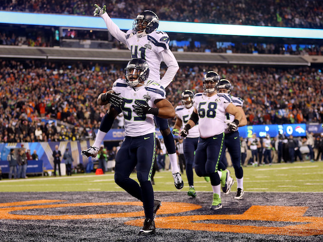 Outside linebacker Malcolm Smith #53 of the Seattle Seahawks celebrates his 69-yard touchdown with teammates after intercepting a pass against the Denver Broncos on February 2, 2014