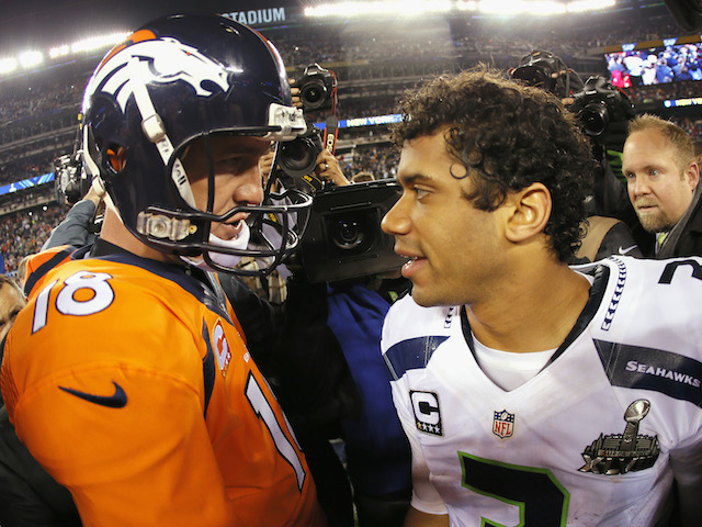 Quarterback Peyton Manning #18 of the Denver Broncos congratulates quarterback Russell Wilson #3 of the Seattle Seahawks on their 43-8 win on February 2, 2014