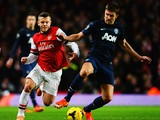 Michael Carrick of Manchester United holds off Jack Wilshere of Arsenal during the Barclays Premier League match between Arsenal and Manchester United at the Emirates Stadium on February 12, 2014