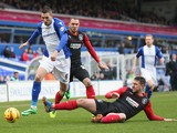 Federico Macheda of Birmingham tangles with Anthony Gerrard of Huddersfield Town during the Sky Bet Championship match between Birmingham City and Huddersfield Town at St Andrews (stadium) on February 15, 2014