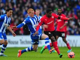 Wigan player Ben Watson challenges Wilfried Zaha of Cardiff during the FA Cup Fifth Round match between Cardiff City and Wigan Athletic at Cardiff City Stadium on February 15, 2014