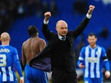 Wigan manager Uwe Rosler celebrates with the fans after the FA Cup Fifth Round match between Cardiff City and Wigan Athletic at Cardiff City Stadium on February 15, 2014
