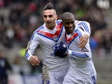 Lyon's Gueida Fofana is congratulated by teammate Miguel Lopes after scoring the opening goal against Ajaccio during their Ligue 1 match on February 16, 2014