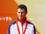 Joe Glanfield of Great Britain celebrates with his silver medal after finishing second placed overall in the Men's 470 class event held at the Qingdao Olympic Sailing Center during day 10 of the Beijing 2008 Olympic Games on August 18, 2008