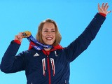 Gold medalist Lizzy Yarnold of Great Britain celebrates on the podium during the medal ceremony for the Women's Skelton on day 8 of the Sochi 2014 Winter Olympics on February 15, 2014