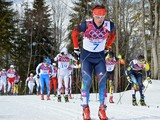 Russia's Maxim Vylegzhanin competes in the Men's Cross-Country Skiing 15km + 15km Skiathlon at the Laura Cross-Country Ski and Biathlon Center during the Sochi Winter Olympics on February 9, 2014