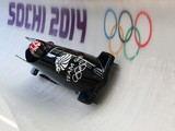 Lamin Deen of Great Britain pilots a run during a Men's Two-Man Bobsleigh training session on day 7 of the Sochi 2014 Winter Olympics at the Sanki Sliding Center on February 14, 2014
