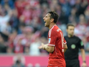 Bayern Munich's Peruvian striker Claudio Pizarro celebrates the fourth goal for Munich during the German first division Bundesliga football match FC Bayern Munich vs Sport Club Freiburg in Munich, southern Germany on February 15, 2014