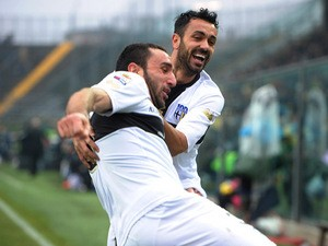 Parma's Cristian Molinaro celebrates with teammate Raffaele Palladino after scoring the opening goal against Atalanta during their Serie A match on February 16, 2014