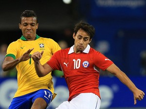 Jorge Valdivia #10 of Chile plays the ball up field as Luiz Gustavo #17 of Brazil defends during a friendly match at Rogers Centre on November 19, 2013