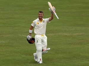 David Warner of Australia celebrates after reaching 100 runs during day three of the First Test match between South Africa and Australia on February 14, 2014