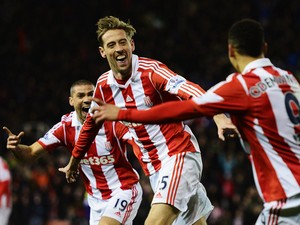 Peter Crouch of Stoke City celebrates after scoring during the Barclays Premier League match between Stoke City and Swansea City at the Britannia Stadium on February 12, 2014