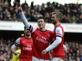 Laurent Koscielny of Arsenal celebrates with team-mates Olivier Giroud of Arsenal and Per Mertesacker of Arsenal after scoring their third goal during the Barclays Premier League match between Arsenal and Sunderland at Emirates Stadium on February 22, 201