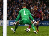 Daniel Alves of Barcelona scores his team's second goal during the UEFA Champions League Round of 16 first leg match against Manchester City on February 18, 2014