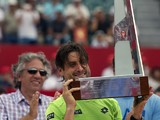 Spanish tennis player David Ferrer poses with the 2014 ATP Buenos Aires trophy after defeating Italian Fabio Fognini 6-4, 6-3, on February 16, 2014