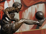 The statue of former Arsenal and Netherlands footballer Dennis Bergkamp after it was unveiled outside The Emirates Stadium in north London on February 22, 2014
