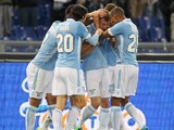 Stefan Radu of SS Lazio celebrates with his team-mates after scoring the opening goal during the Serie A match between SS Lazio and US Sassuolo Calcio at Stadio Olimpico on February 23, 2014