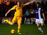 Lee Minshull of Newport takes a shot at goal during the Sky Bet League Two match between Newport County and Oxford United at Rodney Parade on February 18, 2014