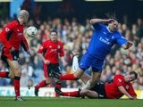Lucas Neill, then of Blackburn Rovers, slides in to win the ball against Chelsea on February 22, 2003.