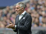 Hanover's head coach Mirko Slomka reacts during the German first division Bundesliga football match Bayern Munich vs Hannover 96 in Munich, southern Germany, on September 14, 2013