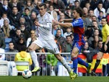 Real Madrid's Welsh striker Gareth Bale vies with Elche's midfielder Alberto Rivera during the Spanish league football match Real Madrid vs Elche at the Santiago Bernabeu stadium in Madrid on February 22, 2014